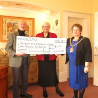 Presenting a cheque to the Mayor